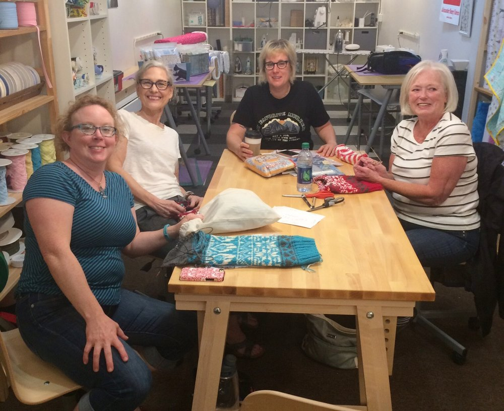 Here's Johnna (black tshirt) Teaching our recent colorwork class. Her students made some pretty cool stockings.