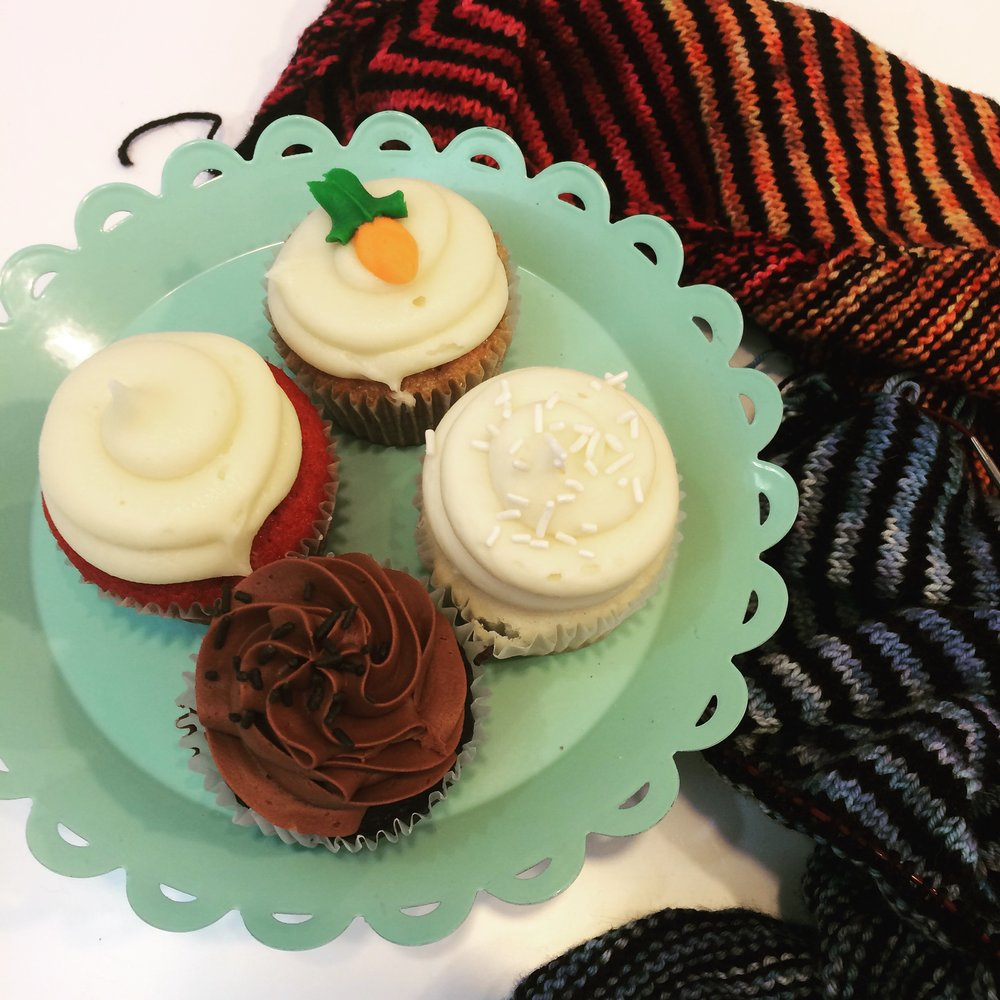 We had tasty cupcakes from Sarah Jane's Bakery and I almost have my Wonderland Yarns Which Way shawl.