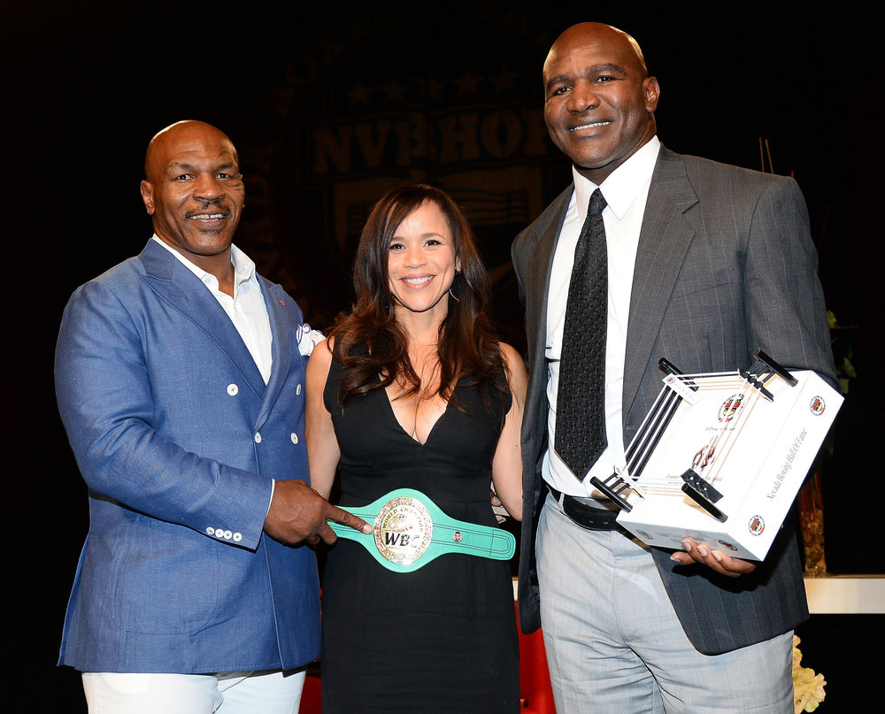 mike-tyson_rosie-perez_evander-holyfield-nbhof-photo-by-ethan-miller_gettyimages.jpg