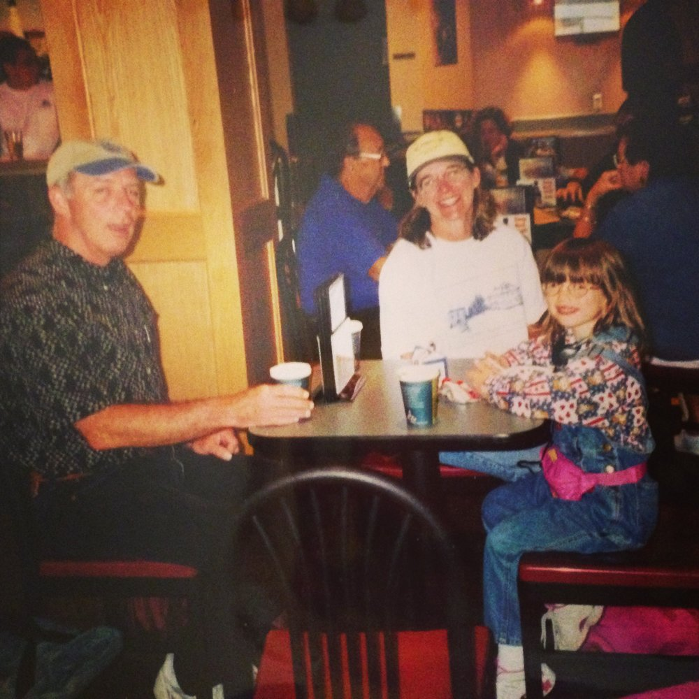 My family having a snack during a trip, and before TSA. Check that sweet fanny pack out.