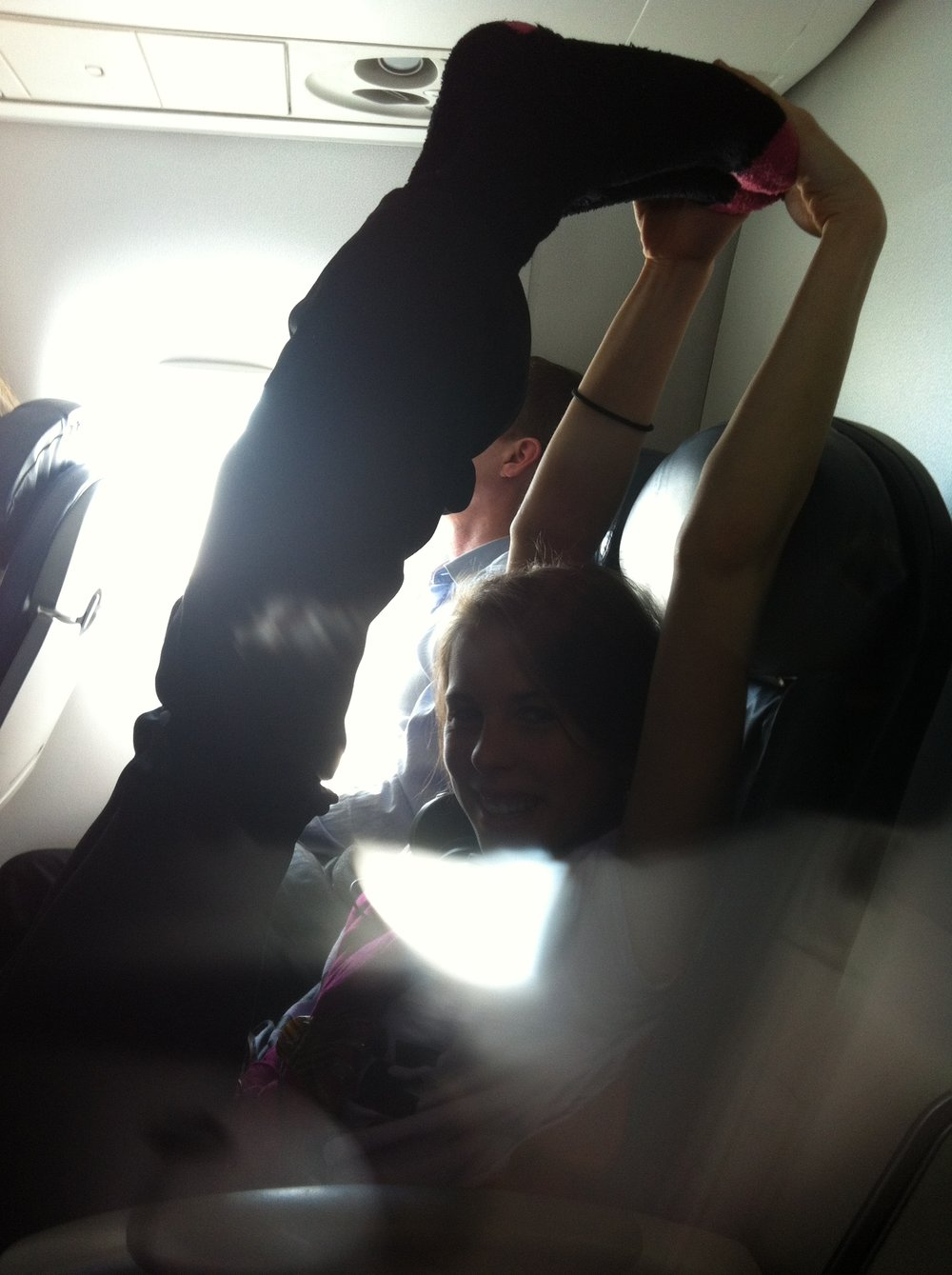 A REAAAAALLY bad picture of me stretching it out during a flight on Majestic Sparkle Unicorn Wings.