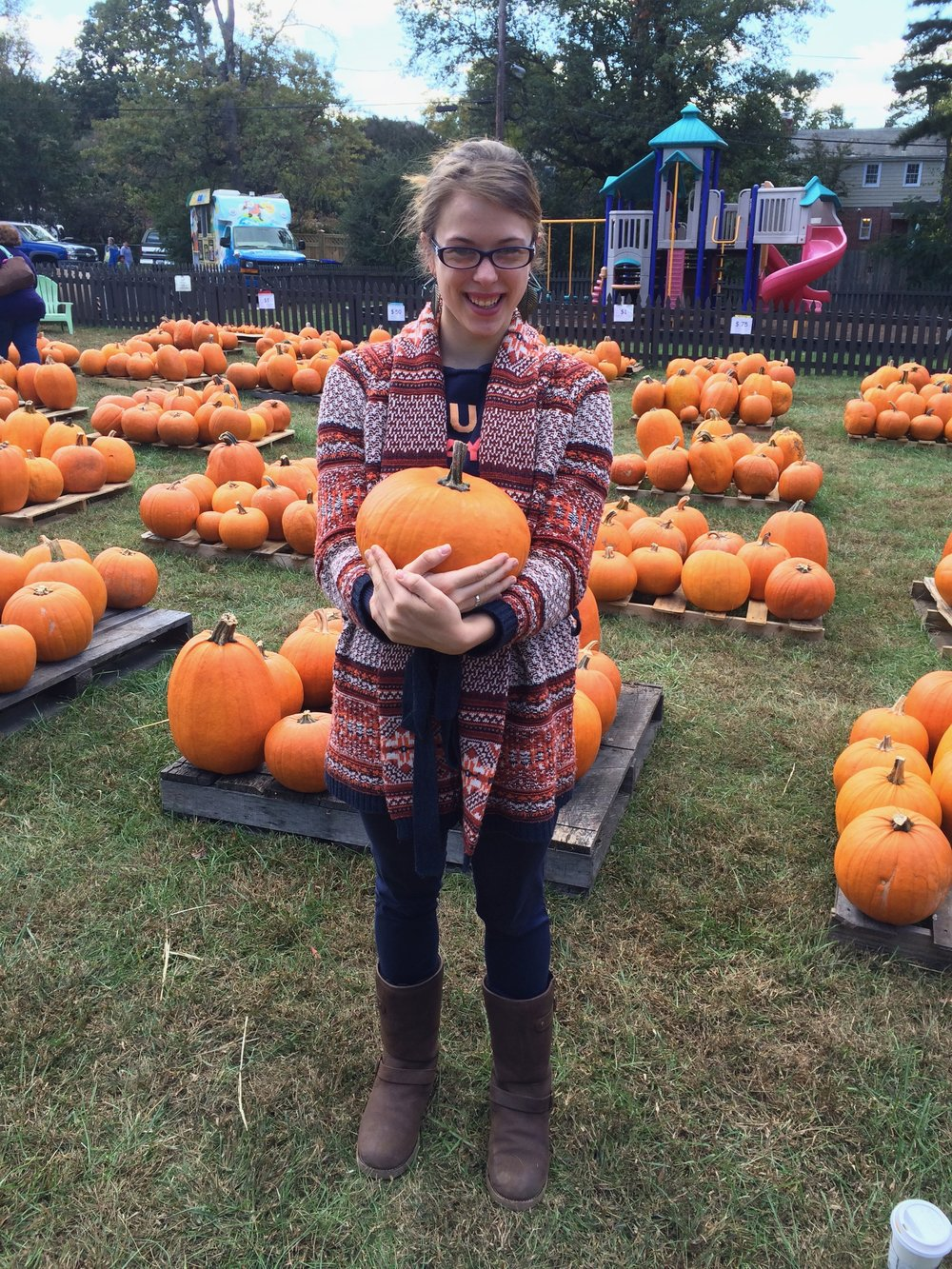 A REALLY bad picture of me with some fruit. But hey, this is a fruit themed post. Yes, the internet says pumpkins are fruit. No, I did not buy this pumpkin from the Fruit Meister.