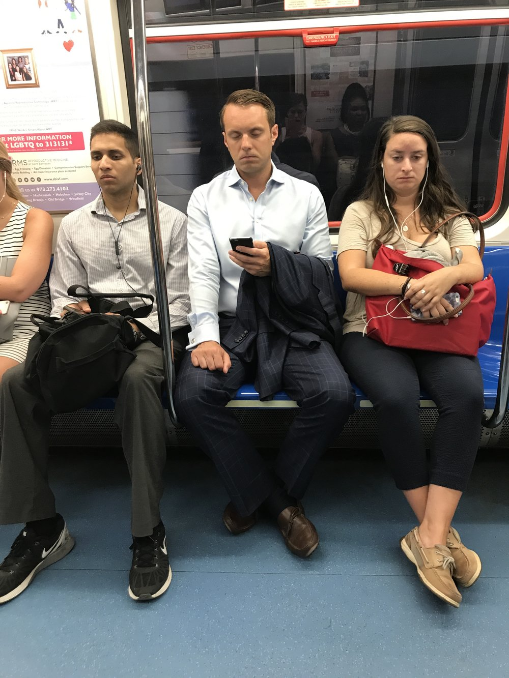 An example of man spreading on the PATH, the woman next to him looks THRILLED