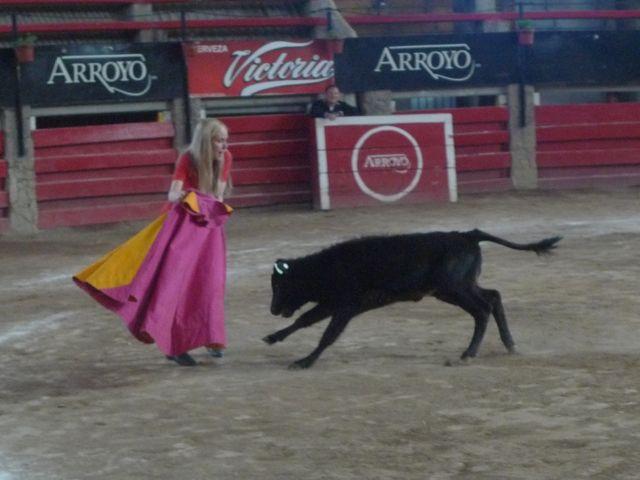 "My sister Amy participating in a mock ""bullfight"" at El Arroyo Restaurant."