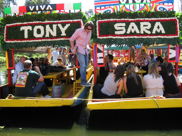 The specialized boats we had made with our names for our wedding-- on the canals of Xochimilco.