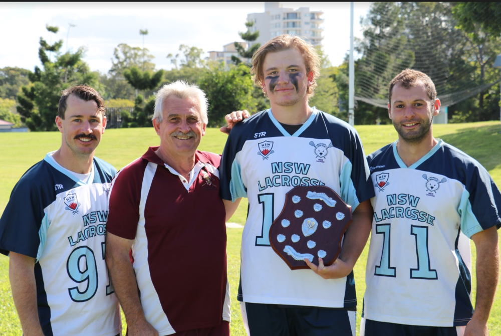 Captains Michael I-i, Jack Stokes and Omar Al-Khayat with the shield.