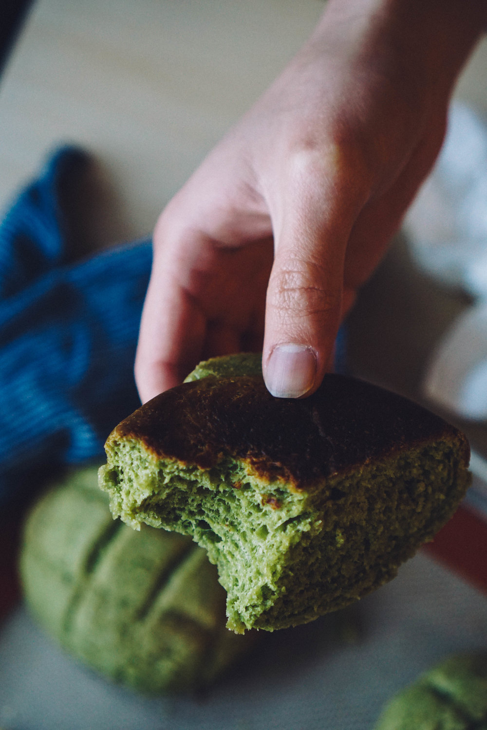 matcha buns half eaten close up