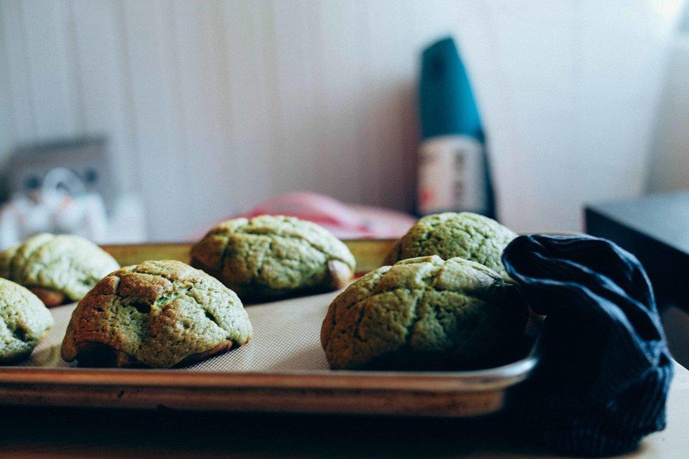 Matcha melon pans cooling on baking sheet