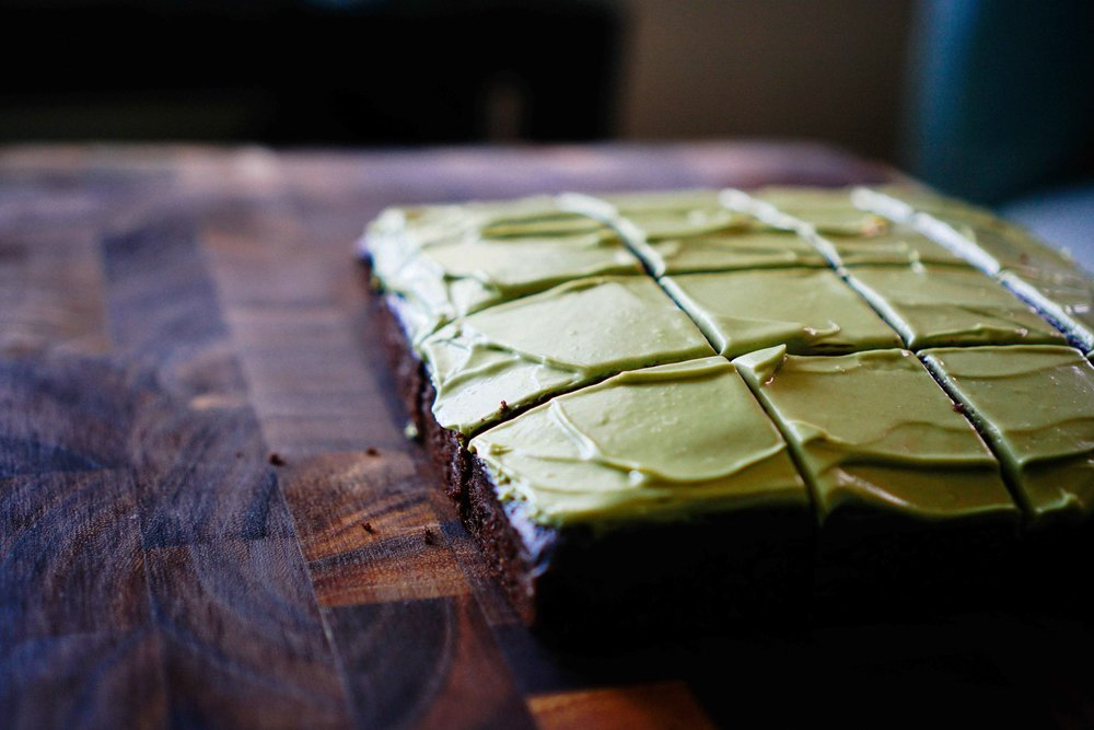 Zucchini Matcha Cake, frosted and ready to be served with some tea