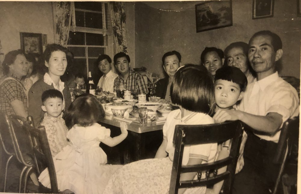 The Yee Family having a celebration dinner at their home on Hudson Street.