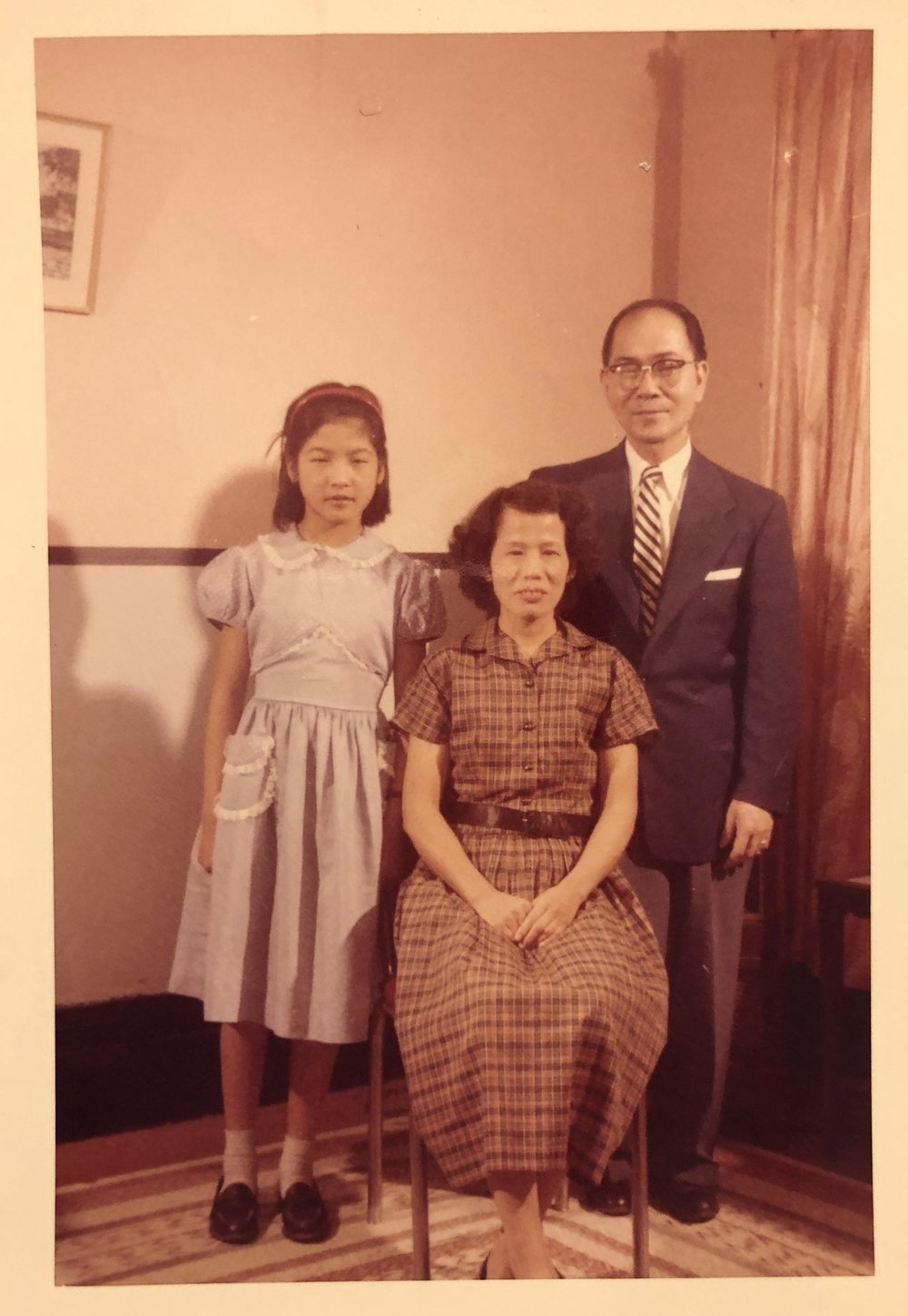 Cynthia Yee, wearing her first store-bought dress, with her parents, May Soon Gee and Walter Yee, 116 Hudson Street, 1959.  (photo taken by Eddie Moon Fun Yee)