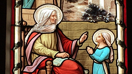 Our Blessed Virgin Mother obediently listens to her mother, St. Anne