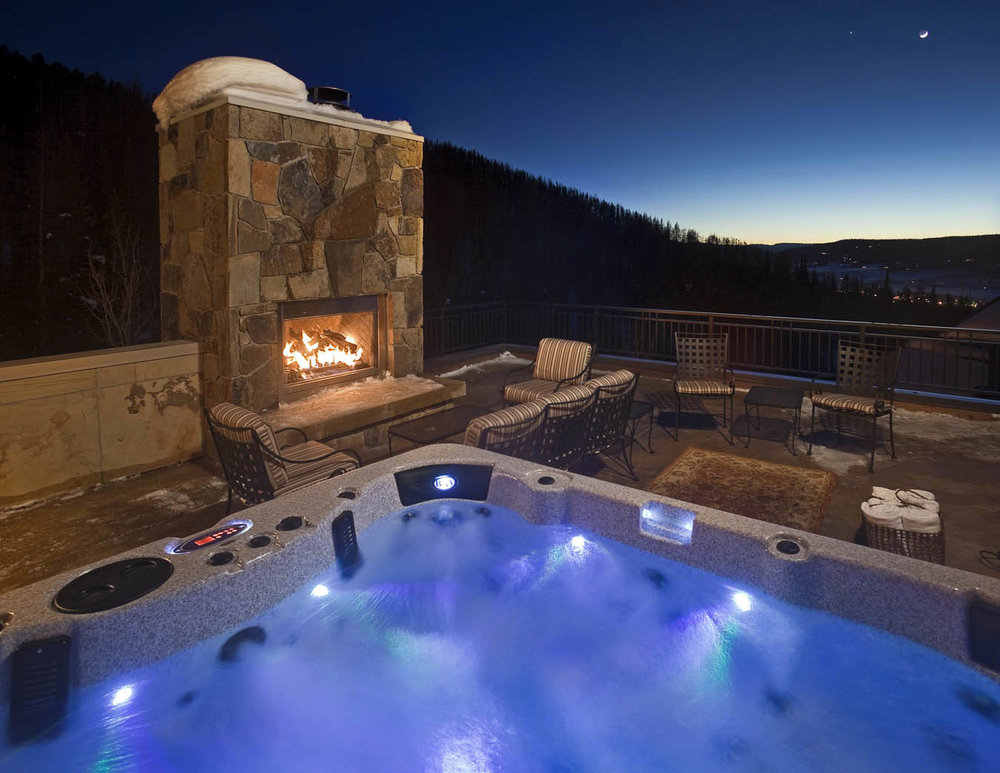 Roof top fireplace and hot tub.