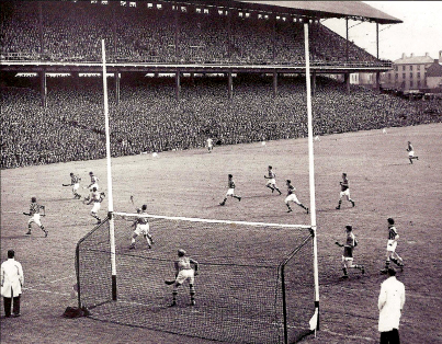 1950 All-Ireland Final. Tipperary beat Kilkenny 1-9 to 1-8 before 68,599 spectators. Jimmy Langton [Kilkenny, No 12) threatens the Tipperary goal.