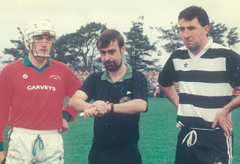 M. Quinn (Referee) about to throw in the ball before the Munster Club final at Mitchelstown, December 1991. Cashel King Cormac's captain, Colm Bonnar, and Midleton captain, Ger Fitzgerald.
