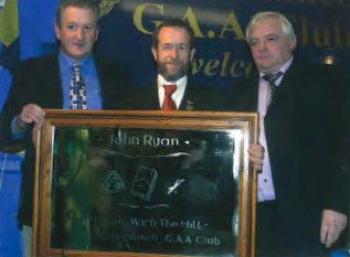 "John Ryan (left) the author of Ballinahinch G.A.A. club history ""Playing with the Hill"" receives a presentation from G.A.A. President Sean Kelly who launched the book and Ballinahinch Chairman John 'Rockie' McGrath."