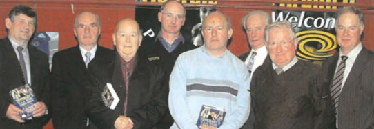 At the Tipperary History launch in Thurles on left is Munster Council Chairman and a group, each of whom has already published books.  From left are Seamus King, Marcus De Burca, Martin Bourke, J.J.Kennedy, Bill Callaghan of Litho Press, Seamus Leahy and Liam O'Donnchu.