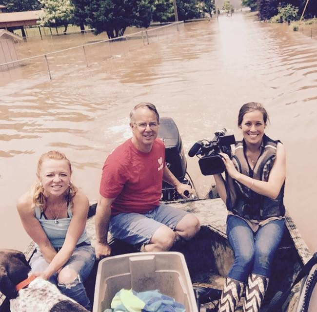 Flood victims giving me a tour of their neighborhood by boat, June 2015 in Mayflower, AR.