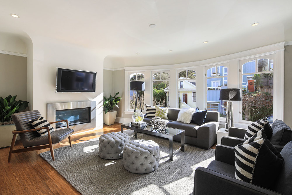 A well appointed living room with plenty of room to lounge and entertain.