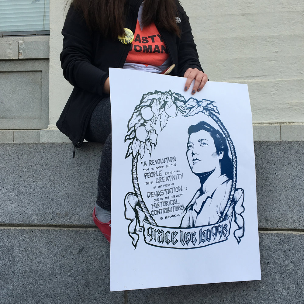 Youth holding poster at Womyn's March, Oakland, CA
