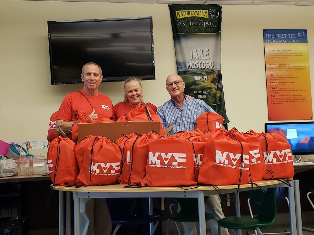 """Dr. Lerner, Chris & Dr. Richter always have a good time preparing the """"swag bags"""" before the tournament!"""