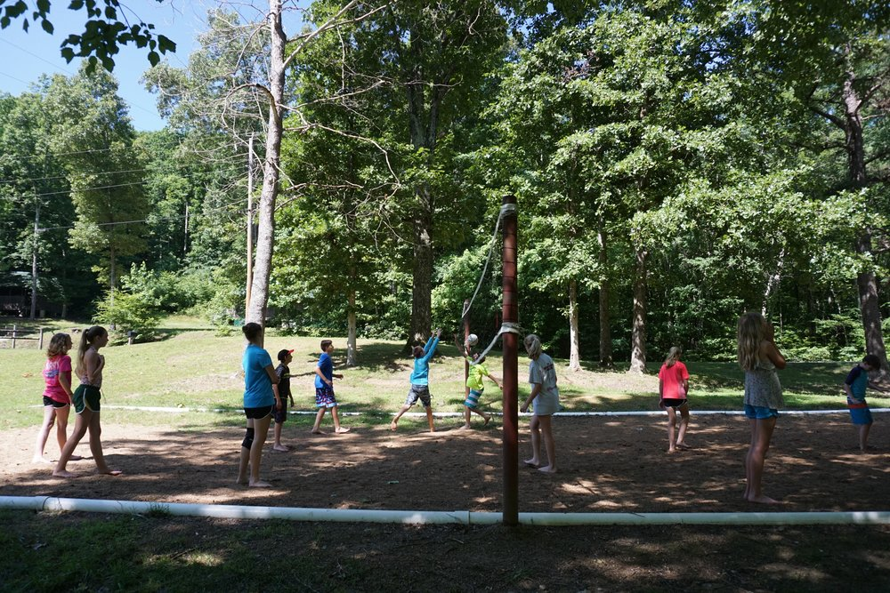 Young Summer Campers playing vollyball - NaCoMe Camp & Conference Center
