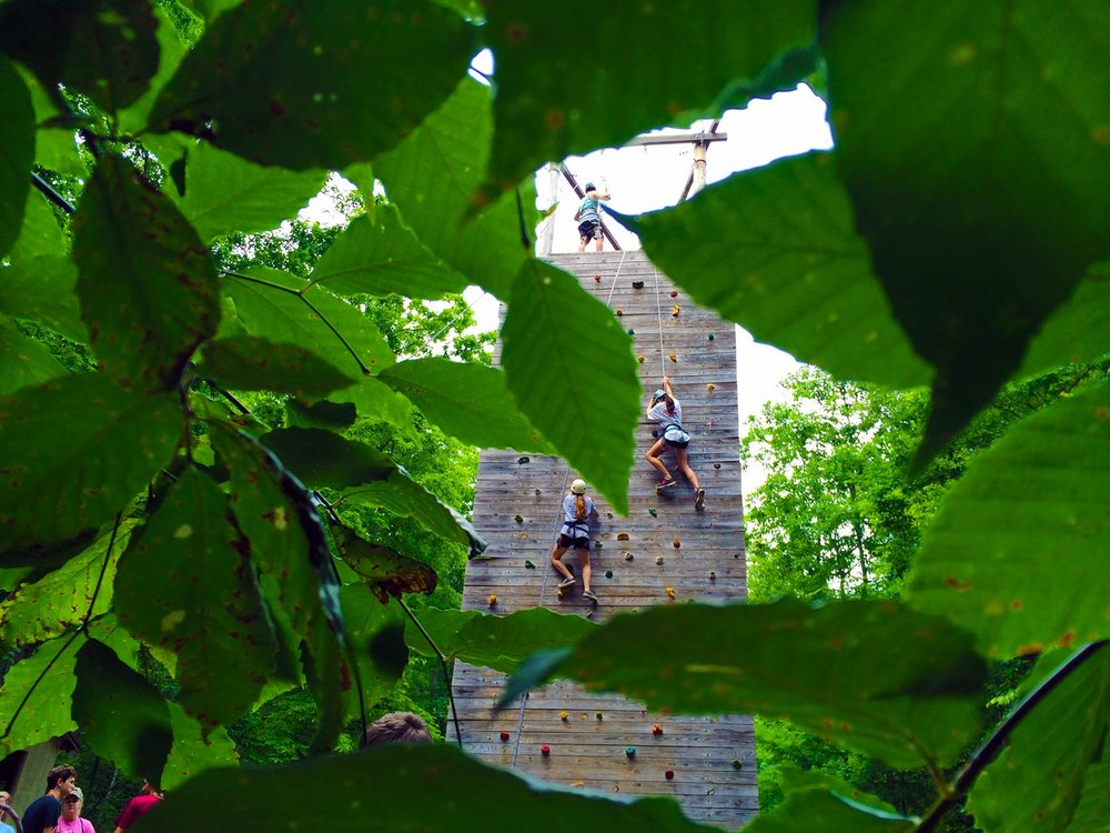 Kids rock climbing at NaCoMe Camp & Conference Center