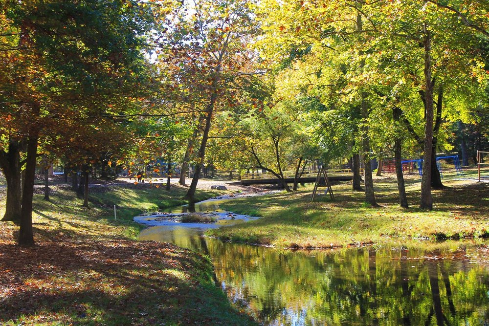 Beautiful scenic creek with a bridge - NaCoMe Camp & Conference Center
