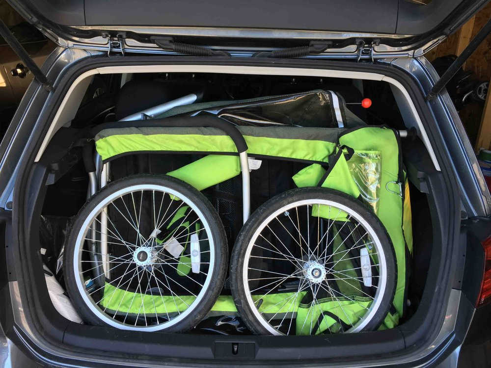 Packing up the bike trailer in the VW golf. Ended up getting a hitch reducer so we can take the bike rack on our SUV. Too hard packing this in every time!