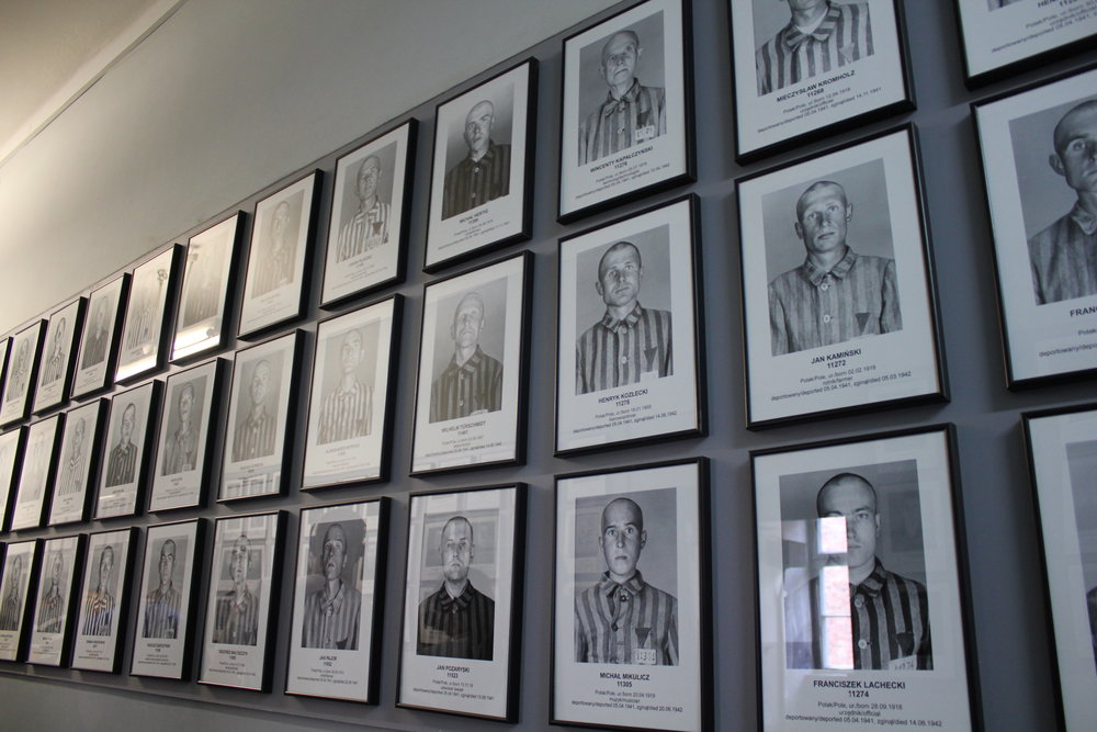 Photos of Holocaust victims, taken from the Nazi files, are hung up along this wall to honour their memory