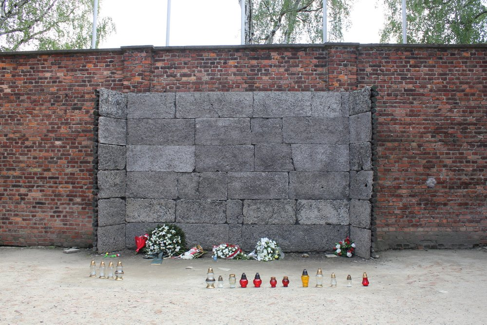 "The infamous ""death wall"" at the notorious Block 11 of Auschwitz I, where thousands of prisoners were executed"