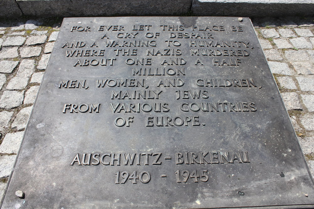 The English memorial plaque at Birkenau – between the ruins of Krema II and Krema III, there lies a row of granite slabs with the above text inscribed in every major language of Europe