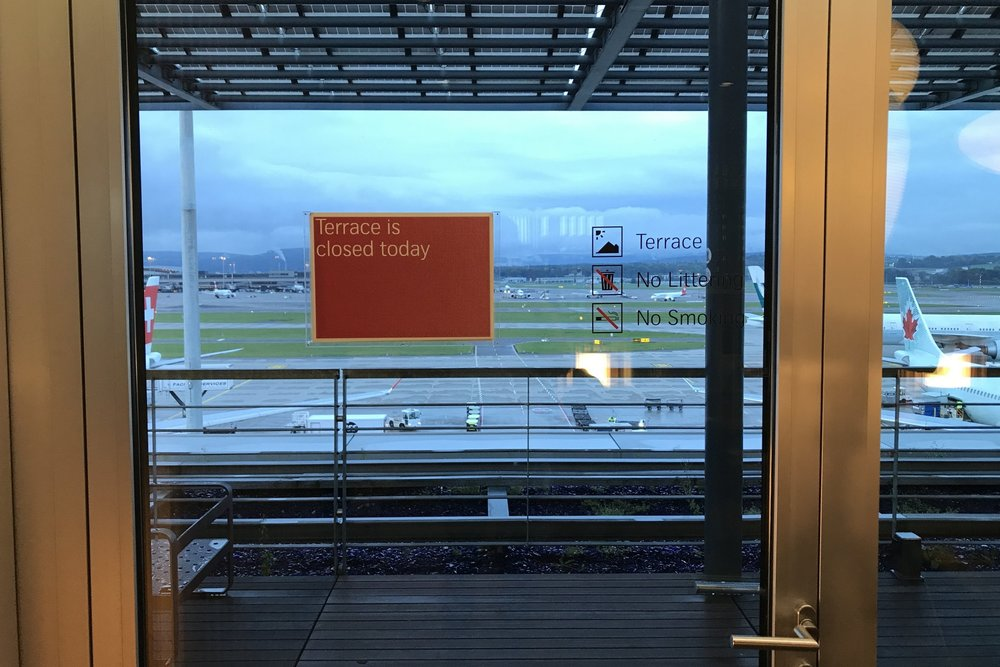 Swiss First Class Lounge Zurich – Terrace sign