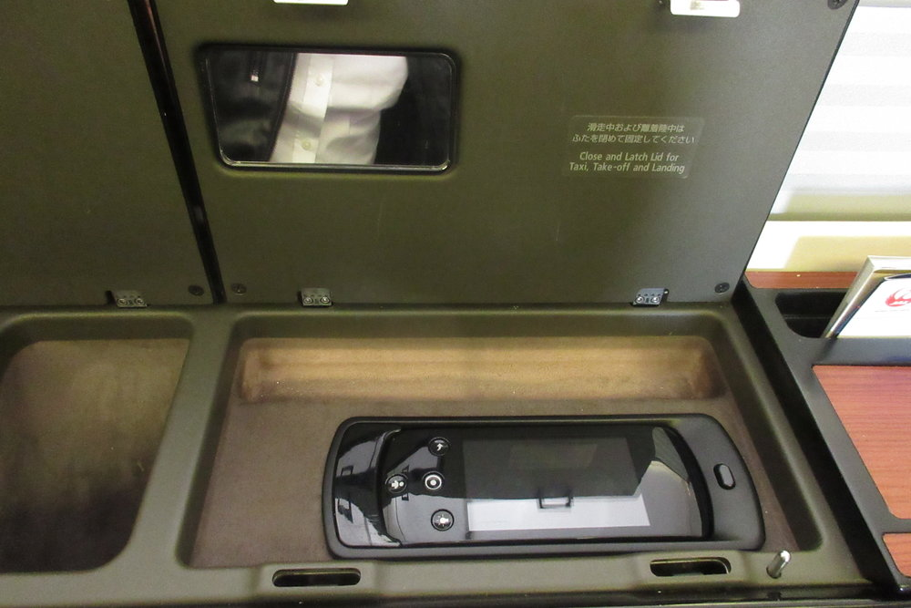 Japan Airlines First Class – LCD entertainment controls and mini mirror