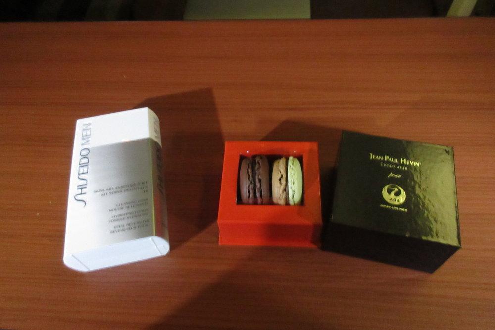 Japan Airlines First Class – Shiseido men's skincare kit and Jean-Paul Hévin macarons