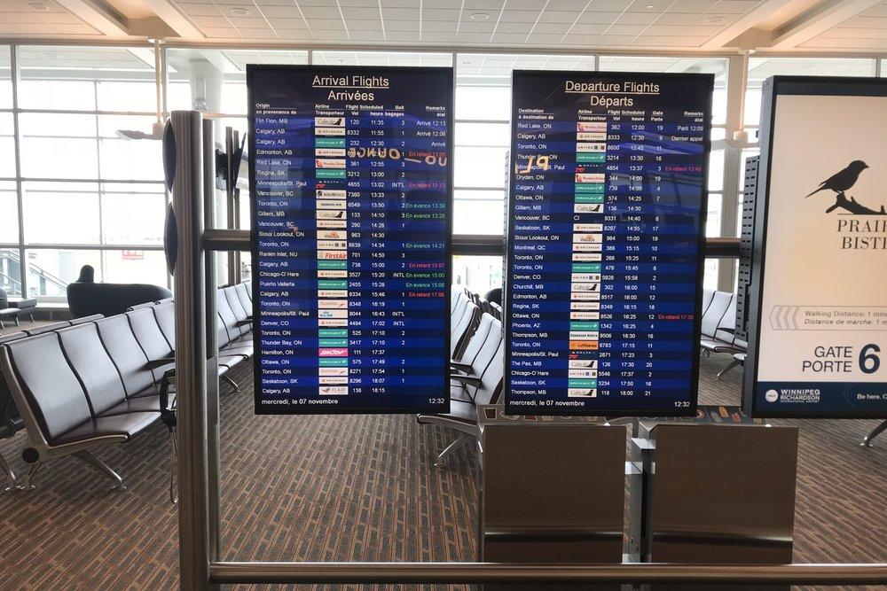 Departures board at Winnipeg Airport
