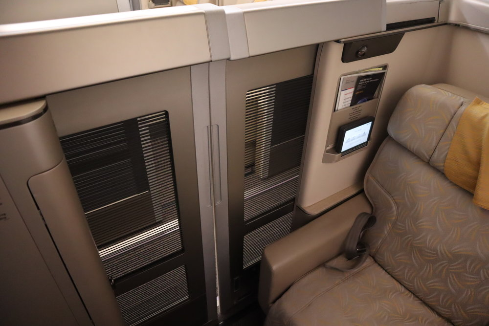 Asiana Airlines First Class – Enclosed suite with doors closed