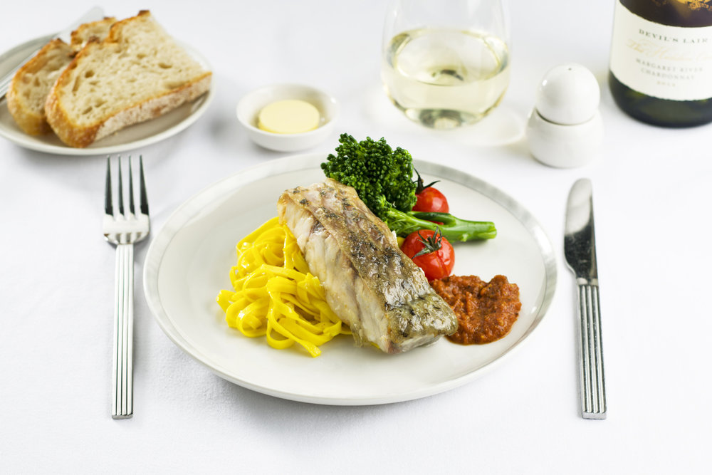 Pan-fried barramundi, available on flights departing from Brisbane