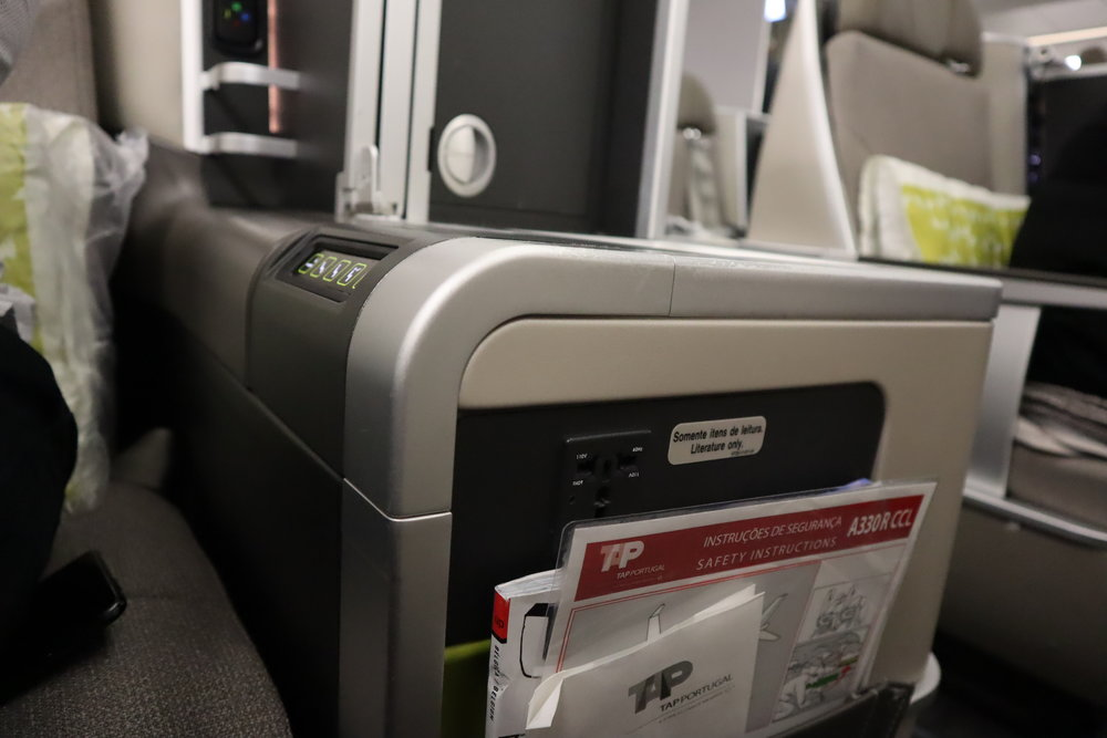 TAP Air Portugal business class – Power port and literature pocket