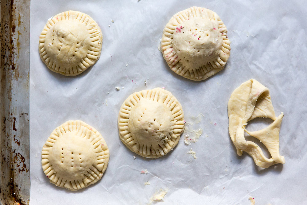 Magenta Hand Pies with Spiced Lentils, Brown Butter Leeks, + Goat Cheese
