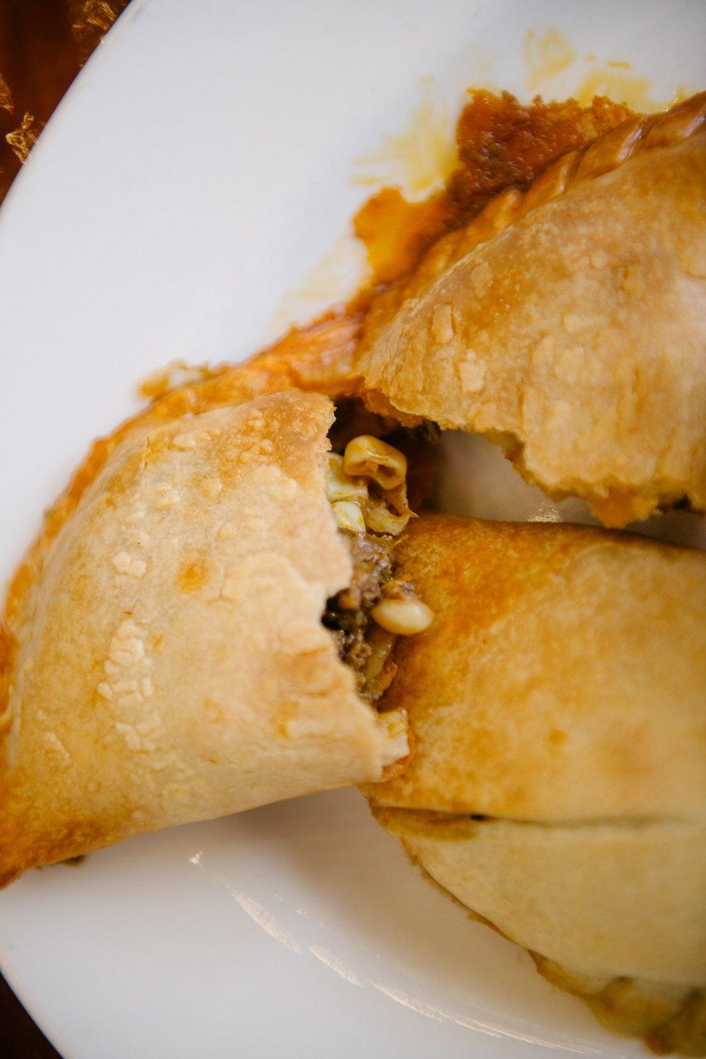 Luna empanadas stuffed with pork carnita, collards, hominy, and corn