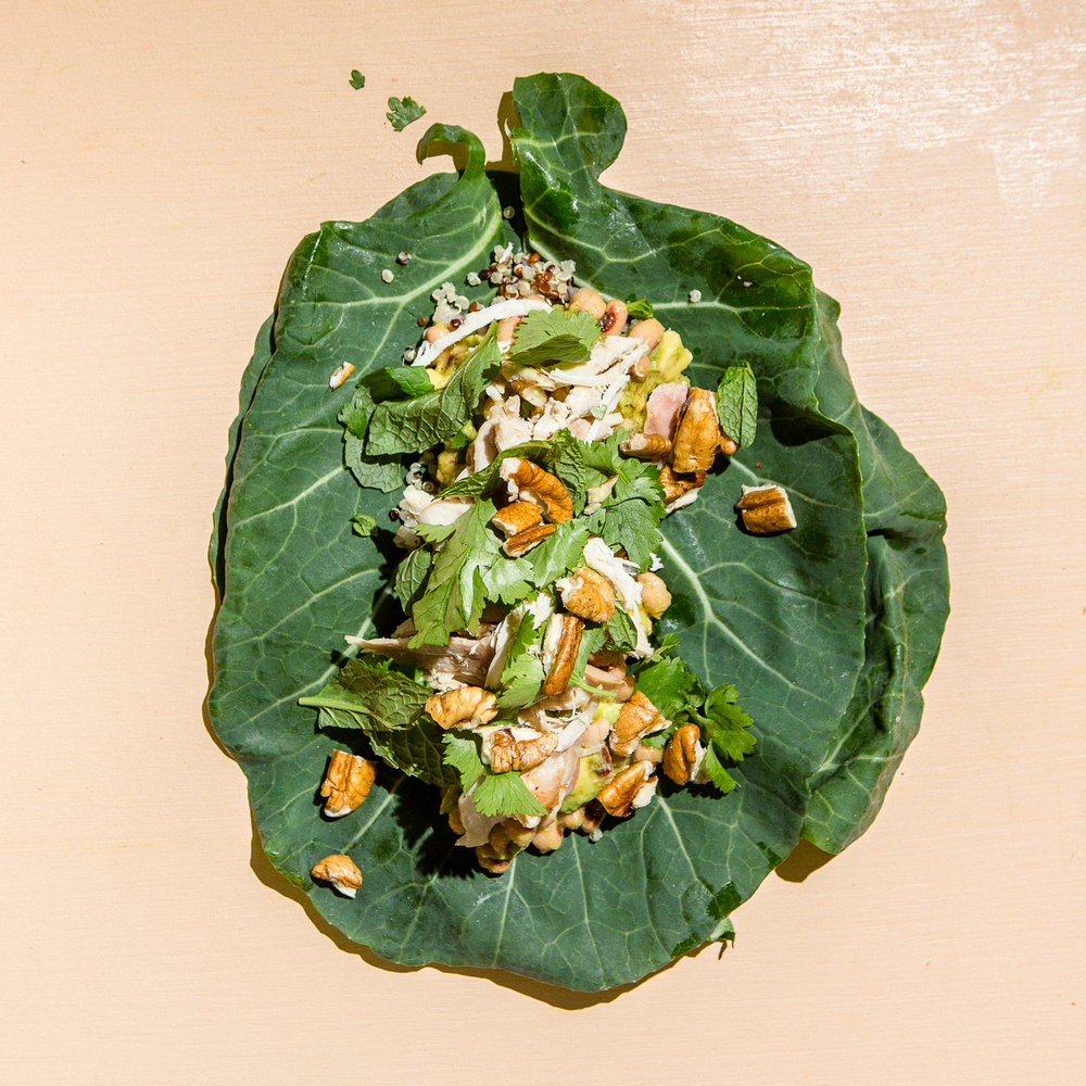 fresh collard wraps with black-eyed peas, roast chicken, herbs and pecans