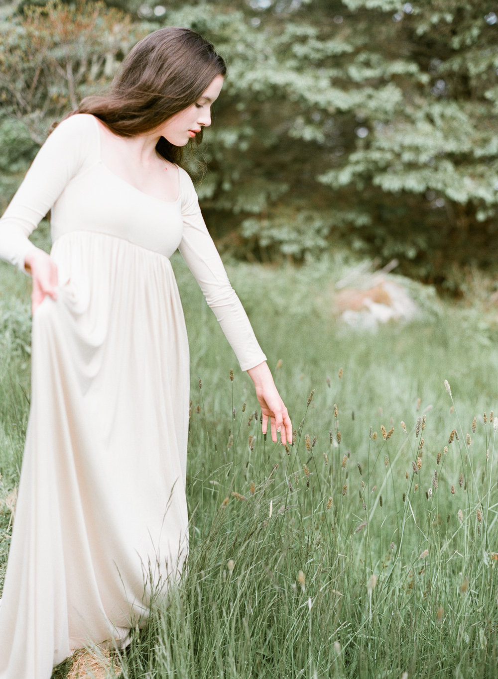 Jacqueline Anne Photography Captured on Film, A Woman in a Cream Dress, walking through long grass