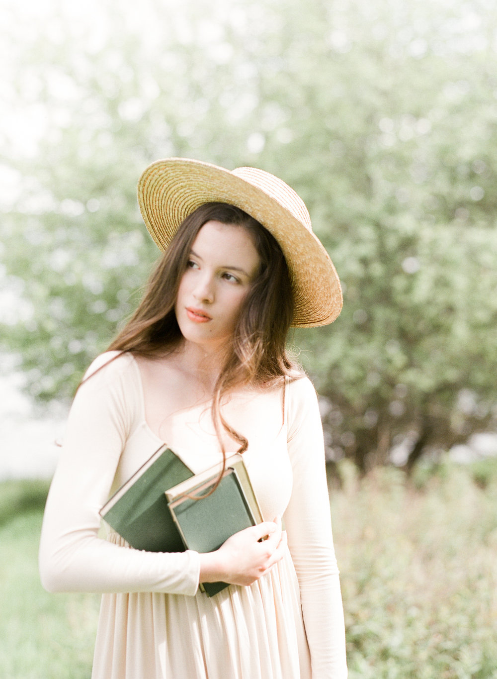 Jacqueline Anne Photography Captured on Film, A Woman in a Cream Dress, holding gardening books