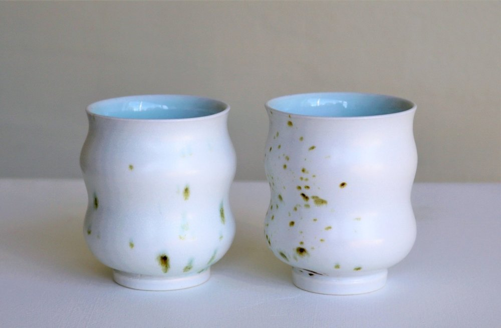 Arnaud Barraud,  Beakers,  porcelain, iron oxide, celadon and eggshell glazes AVAILABLE