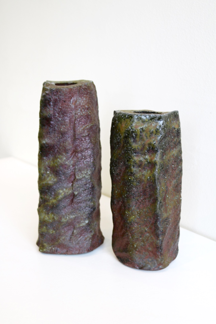 Yuri Wiedenhofer, 43. (Left)  Tall Squared Form,    2018, found high iron clay. 44. (Right)  Tall Form,  2018, high iron clay seam from Hallam Clay Pit. Both: 5.5 day wood firing, Yellow Stringy to start, Black Wattle and Hickory, Melaleuca to finish, Pittosporum undulata (green) final stoke