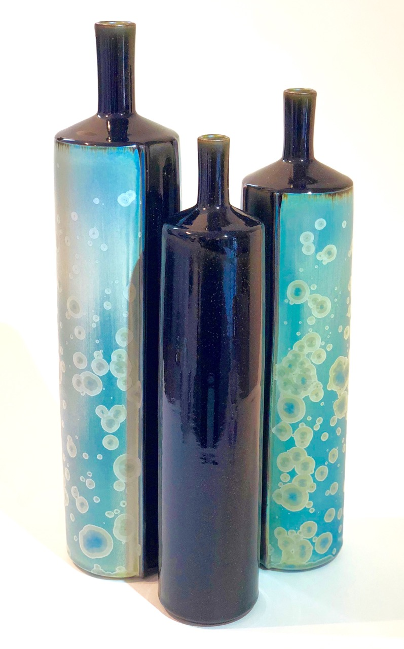 Ted Secombe 2.  Set of 3 Bottles, Kimono Series,  2018, porcelain, blue matt crystalline glaze with black monochromatic panels, heights 43, 38 & 36cm