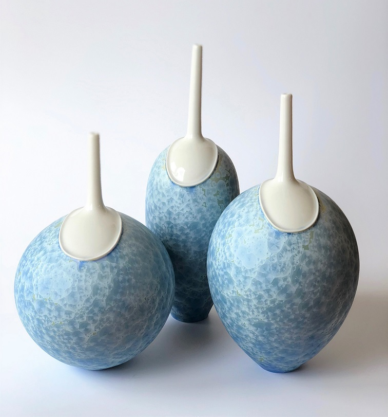 Ted Secombe 55.  Set of 3 Forms , 2018, porcelain, pale blue matt crystalline glaze with white collars, heights 42, 38 & 32cm