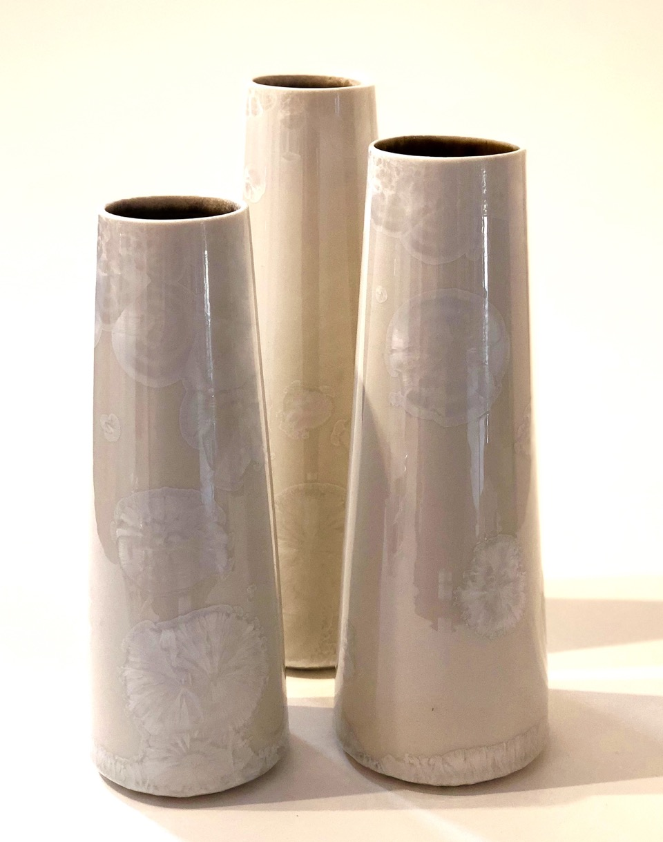 Ted Secombe 12.  Set of 3 Vases,  2018, porcelain, pearl white crystalline glaze, heights 31, 29 & 27cm