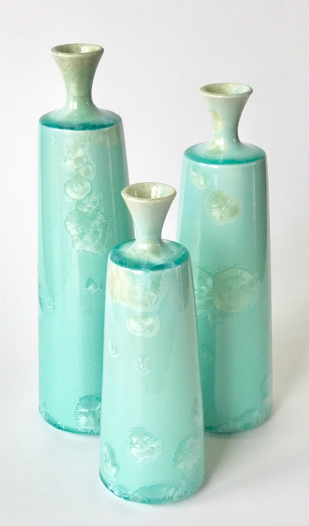 Ted Secombe 43.  Set of 3 Bottles , 2018, porcelain, aquamarine gloss crystalline glaze, heights 34, 31 & 26cm